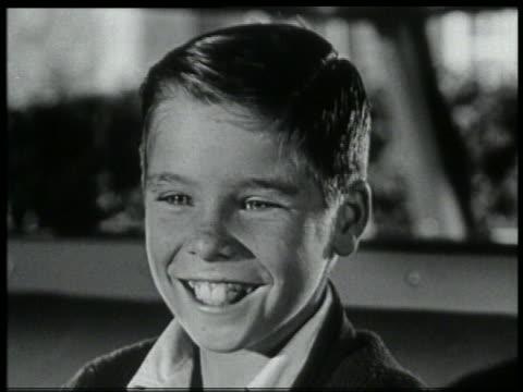 b/w 1959 close up freckle-faced boy smiling + turning head to side - 1959 bildbanksvideor och videomaterial från bakom kulisserna