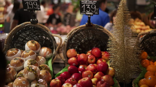 close up, fresh produce in grocery store - one mid adult woman only stock videos & royalty-free footage