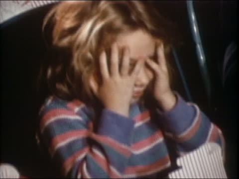 1985 close up frightened preteen girl at movie looking through fingers