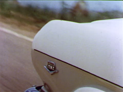 1965 close up front fender of moving white ford mustang / graphics superimposed in shot / industrial - ford mustang stock videos and b-roll footage