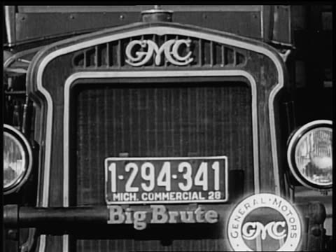 vidéos et rushes de b/w 1928 close up front of gmc truck with michigan license plates / industrial - 1928