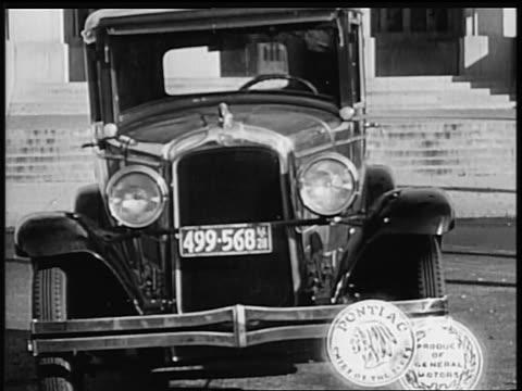 b/w 1928 close up front of pontiac car / industrial - 1928 stock-videos und b-roll-filmmaterial