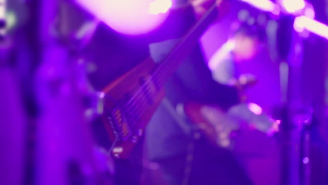 close up front shot a bass while musician plays music. - bass guitar stock videos & royalty-free footage