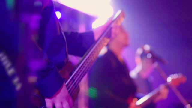 close up front shot a bass while musician plays music. - guitarist stock videos & royalty-free footage