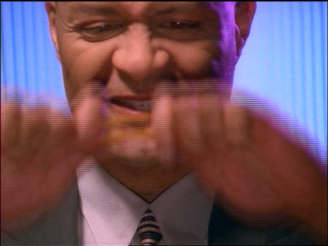 stockvideo's en b-roll-footage met close up frustrated black businessman breaking pencil + gritting teeth - 1998