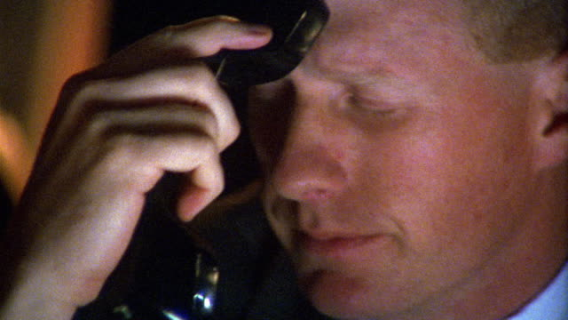 vidéos et rushes de close up frustrated businessman tapping phone against forehead and shaking head / hanging up - secouer