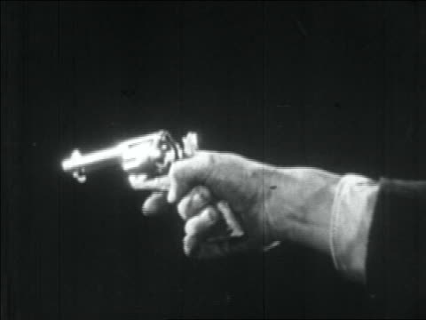 vídeos y material grabado en eventos de stock de b/w 1934 close up gangster's hand shooting pistol - handgun