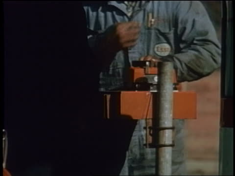 1958 close up gas station attendant using credit card machine - gas station attendant stock videos and b-roll footage