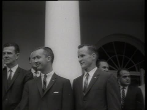 b/w close up gemini astronauts at presidential awards ceremony / ed white jim mcdivitt 1960's / sound - james mcdivitt stock-videos und b-roll-filmmaterial