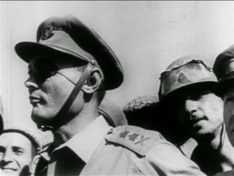 close up general moshe dayan talking outdoors / soldiers in background / suez crisis / middle east - israeli military stock videos & royalty-free footage
