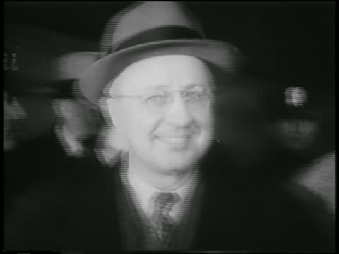 close up george metesky in eyeglasses + hat smiling / people in background - 1957 stock-videos und b-roll-filmmaterial