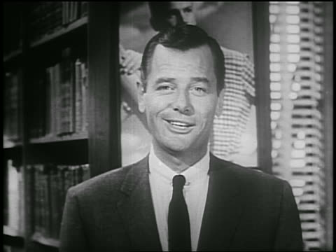 b/w 1955 close up gig young smiles talks to camera then walks away / psa - einzelner mann über 30 stock-videos und b-roll-filmmaterial
