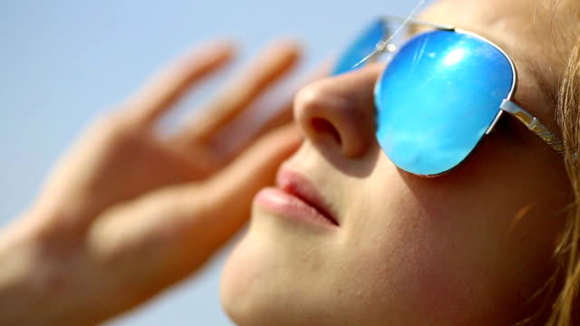 close up - girl in sunglasses - sunglasses stock videos & royalty-free footage