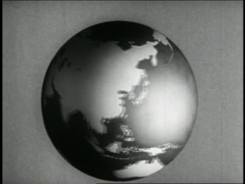 B/W 1942 ANIMATED close up globe spinning / educational