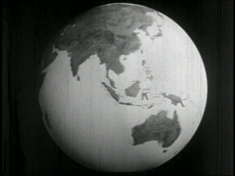 stockvideo's en b-roll-footage met b/w 1938 close up globe spinning / educational - 1938