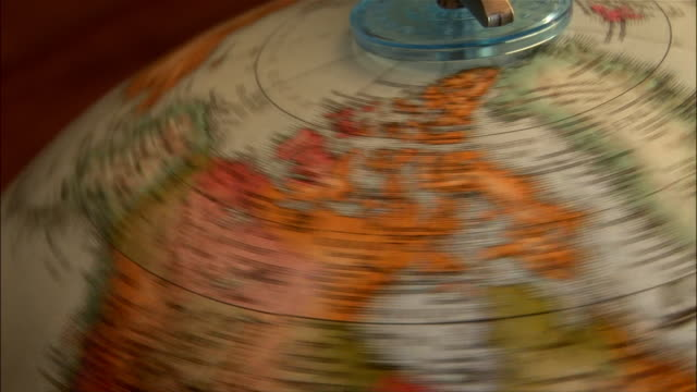 Close up globe spinning / stopping on Bering Strait