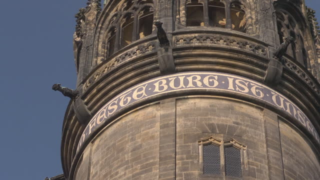"close up golden inscription ""feste burg ist "" at tower of castle church - christianity stock videos & royalty-free footage"