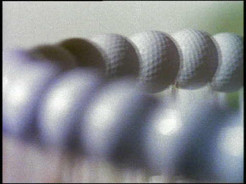 close up golf balls on conveyor belt in factory - golf ball stock videos & royalty-free footage