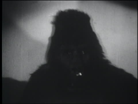 b/w 1948 close up gorilla (costume) looking around - 1948 stock-videos und b-roll-filmmaterial