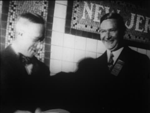 close up governors smith + moore shaking hands at dedication of holland tolland / news. - anno 1927 video stock e b–roll