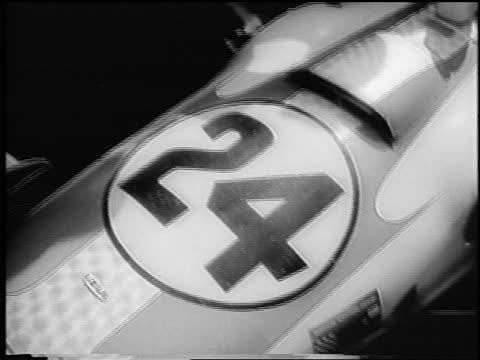 vidéos et rushes de b/w 1966 close up graham hill's race car after winning indianapolis 500 / newsreel - graham hill