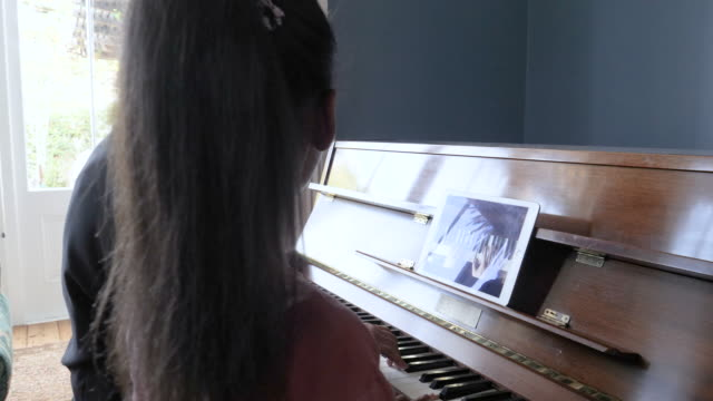 close up, granddaughter and grandmother play piano - grandchild stock videos & royalty-free footage
