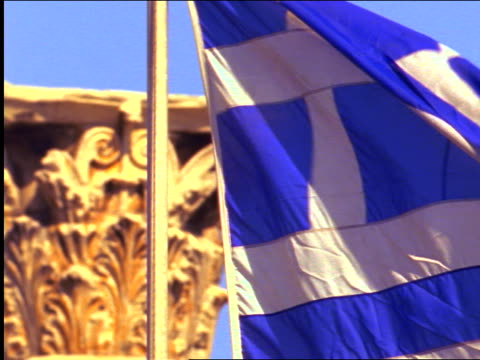close up greek flag waving in front of temple of olympian zeus under blue sky / athens, greece - greek flag stock videos & royalty-free footage