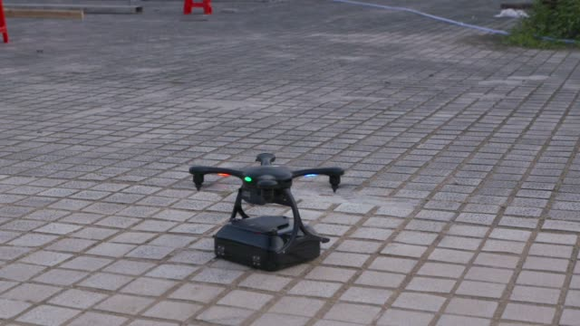 Close up green light flashes on a testing drones at the EHang Inc headquarters in Guangzhou China on Thursday Nov 2 A testing drone takes off flies...