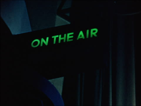 "1941 close up green ""on the air"" sign / industrial - radio studio stock videos & royalty-free footage"