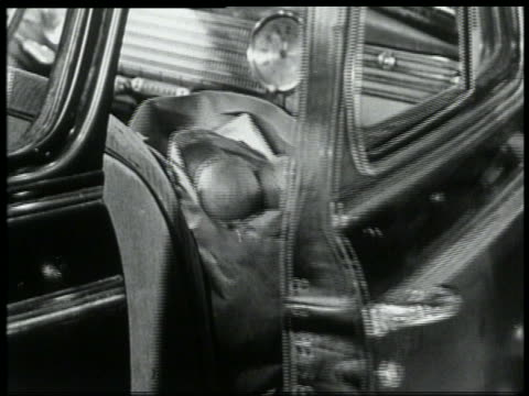 b/w 1959 close up groceries falling out of opening car door - papiertüte stock-videos und b-roll-filmmaterial