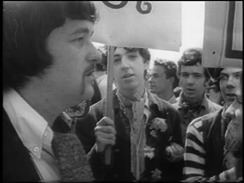 close up group of hippies holding signs at be-in / hyde park, london / newsreel - 1967 stock videos & royalty-free footage
