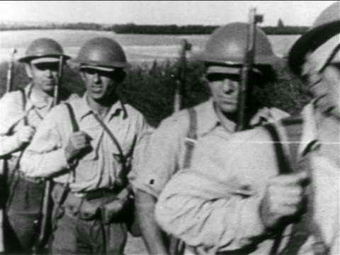stockvideo's en b-roll-footage met b/w 1956 close up group of israeli soldiers walking on country road / suez crisis / middle east - suezcrisis