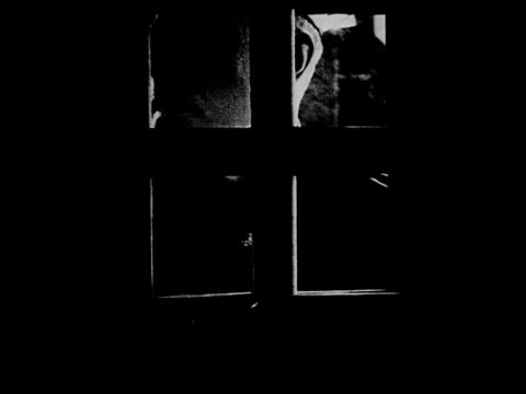 1916 b/w close up guard looking through prison door and unlocking it - prison guard stock videos and b-roll footage