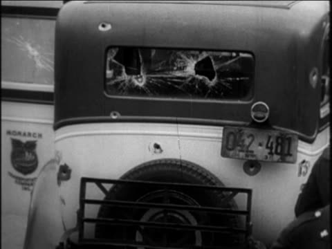 b/w 1921 close up gunshot damage to rear window of car / prohibition / documentary - 1921 stock videos & royalty-free footage