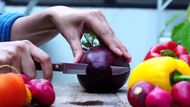 close up hand chef cutting beetroot - beet stock videos & royalty-free footage
