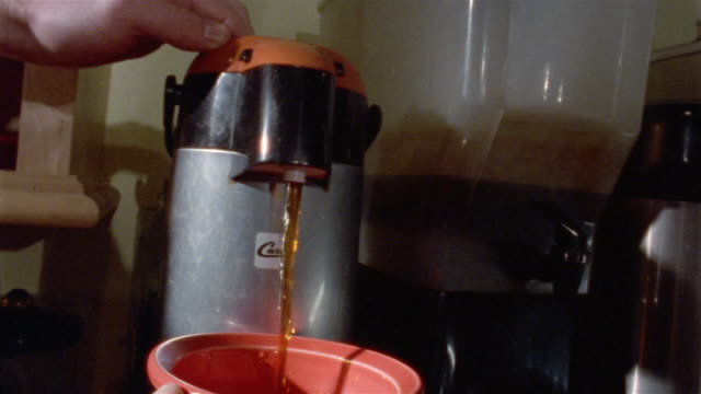 close up hand dispensing hot water into coffee mug - coffee cup stock videos & royalty-free footage