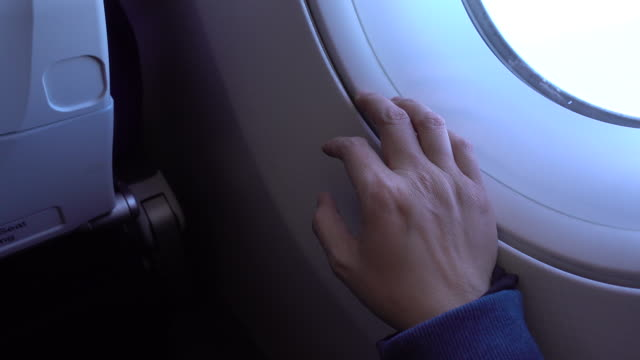 close up hand doing finger knok on window with fear emotion of flying of airplane - phobia stock videos and b-roll footage
