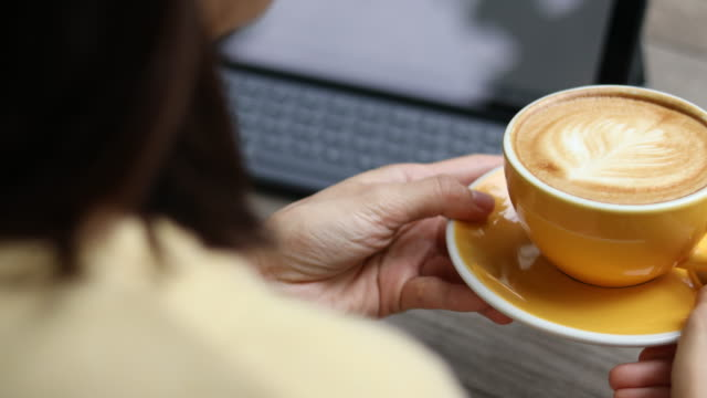 close up hand drinking coffee - coffee drink stock videos & royalty-free footage
