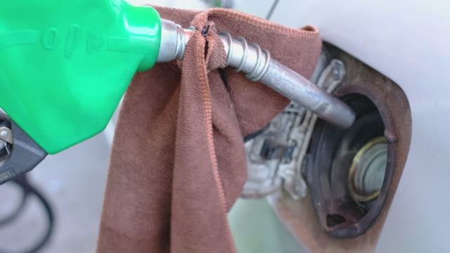 close up hand fill gas at gas station - fuel pump stock videos & royalty-free footage