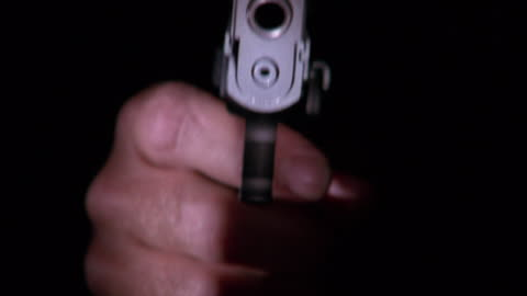 close up hand holding gun and shooting it towards camera - pointing stock videos & royalty-free footage