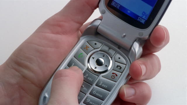 close up hand holding open motorola flip phone and dialing number - button stock videos & royalty-free footage