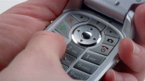 close up hand holding open motorola flip phone and dialing number - 2006 stock videos & royalty-free footage