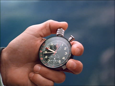 close up hand holding stopwatch / stavanger, norway - stop watch stock videos & royalty-free footage