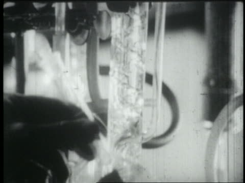 B/W 1965 close up hand holding tubes in scientific lab