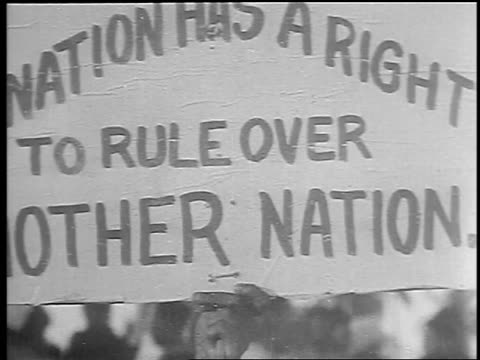b/w 1930 close up hand holding up sign at antibritish rule demonstration / bombay india / newsreel - newsreel stock videos & royalty-free footage