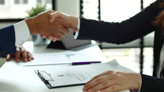close up hand job interview and agreement - lavoro e impiego video stock e b–roll