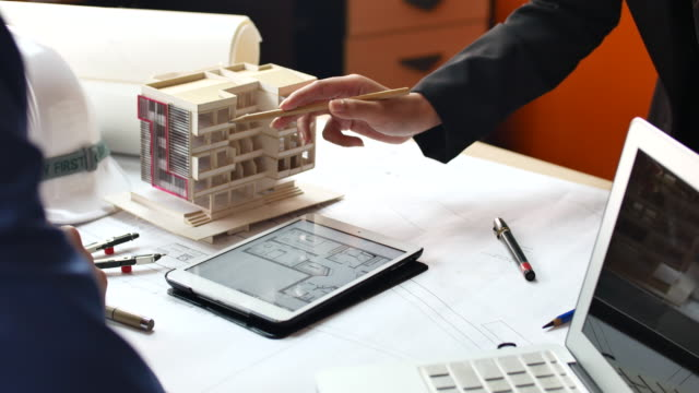 close up hand of architect team working with architectural model and blueprint - architectural model stock videos and b-roll footage