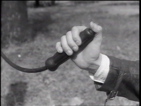 b/w 1938 close up hand of boy holding + thumb pushing traffic light control button / memphis, tennessee - start button stock videos & royalty-free footage