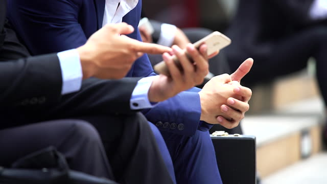 close up hand of businesswoman using smartphone.business concept. - conference phone stock videos & royalty-free footage