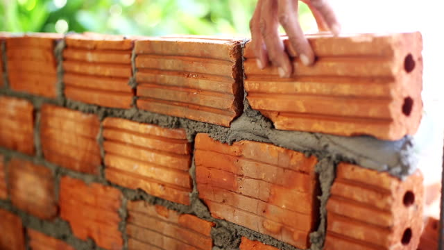 close up hand of man bricklayer for construction HD.